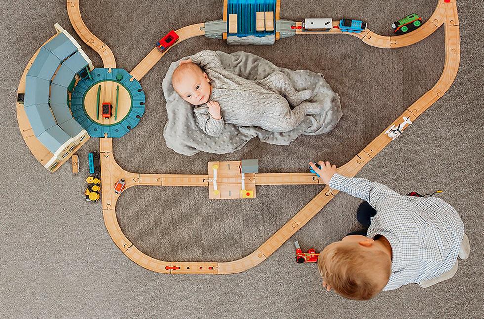 Brisbane newborn photography. Family newborn photography. Brothers. Baby. Newborn. Train set. Thomas. Lifestyle photography Brisbane.